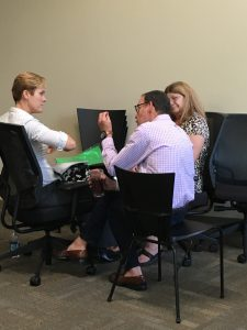 Lary Shrier, Facilitator, assisting two therapists master the protocol